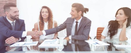 Business people shaking hands, starting a meeting