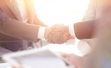 confident handshake of business partners
