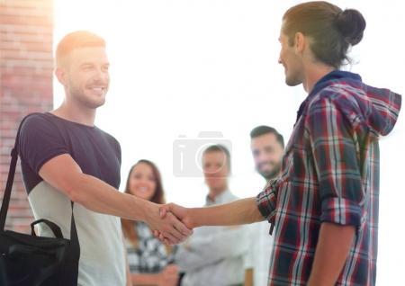 handshake staff of the Agency