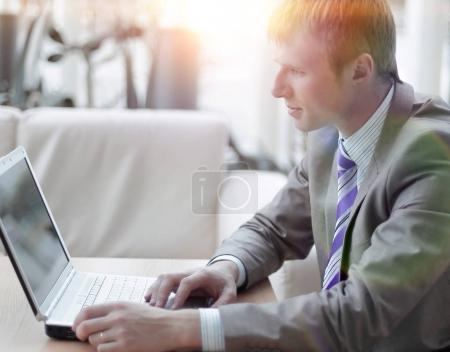 Young employee looking at computer monitor during working day
