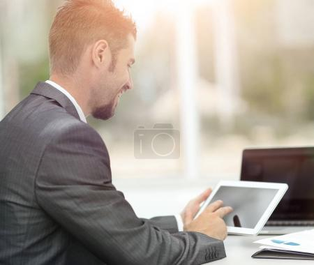 closeup.successful businessman working with tablet computer
