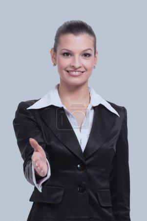 Business woman with her arm out in a welcoming