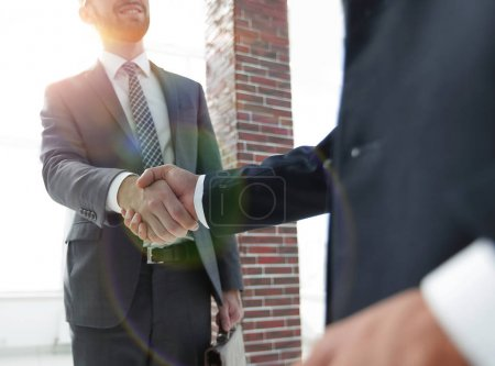 Photo for Business leader shaking hands with partner.vertical photo - Royalty Free Image