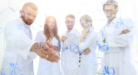 in the background image group laboratory scientists discussing t