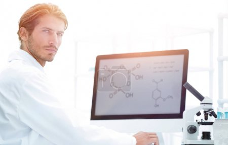 Medical doctor working with microscope in laboratory