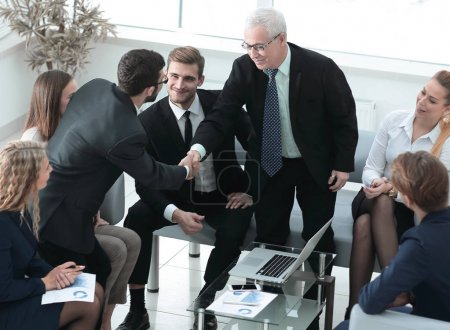 business partners shake hands at a business meeting in the office