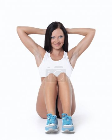 Portrait of a smiling woman doing abdominal crunch
