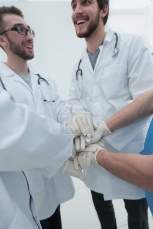 group of doctors,clasped their hands together