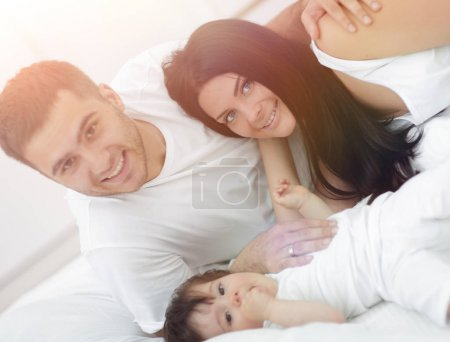 Lovely family morning in the bedroom