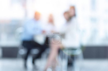 abstract blurred group of business people sitting at a table