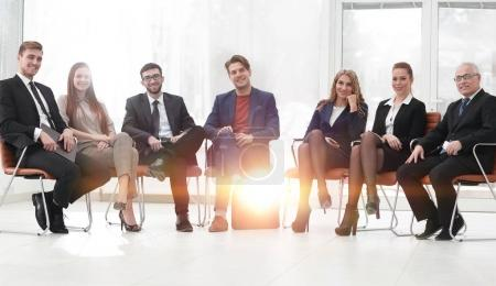 senior businessman and business team sitting in a conference roo