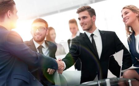 handshake of business people at business meeting in the office