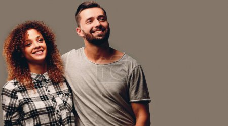 young couple discussing their dreams and pointing forward.