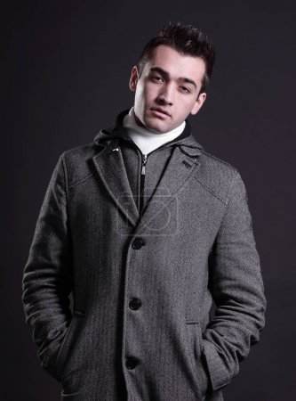 cool real young man in coat