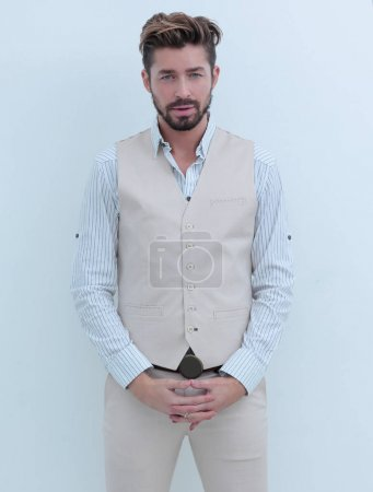 Full length portrait of a businessman looking at the camera