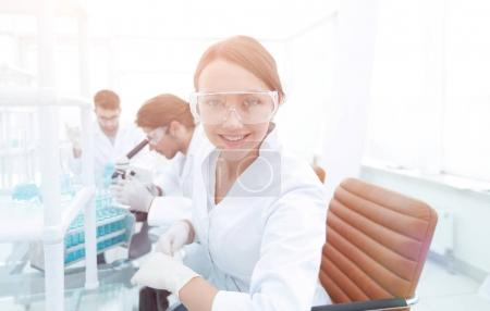 Photo for Female scientist working on chemicals in laboratory - Royalty Free Image