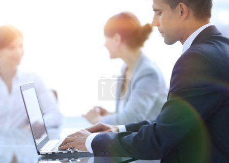 Photo for Closeup of businessman typing on laptop. photo on the background of office - Royalty Free Image