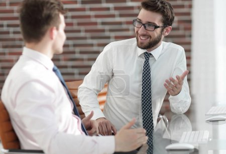 Manager talking with a colleague