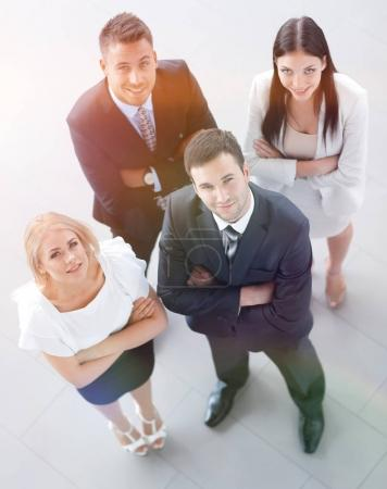 Photo for View from the top.a group of young business people looking at camera. isolated on a white background. - Royalty Free Image