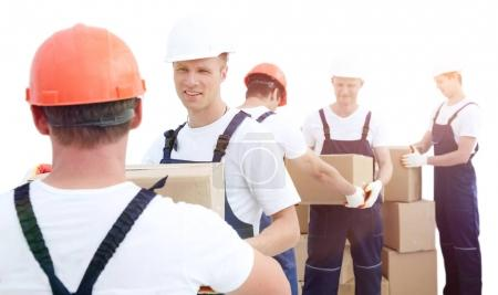 Group of people builders with boxes