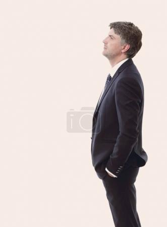 side view. Portrait of serious businessman.