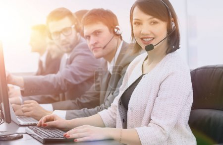 female customer service representative and colleagues in the call center