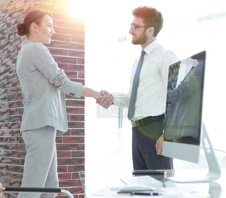Photo for Business background.handshake of business partners on background of blank screens - Royalty Free Image