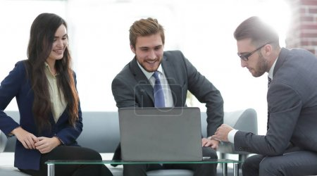 A business team of three planning work in office.