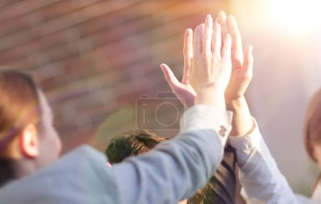 successful business team giving each other a high five