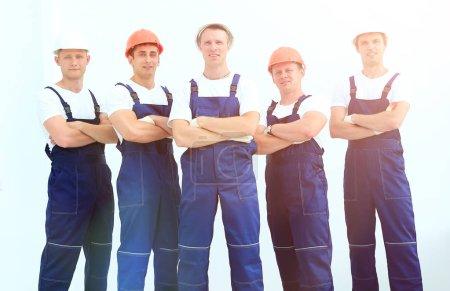 Foto de Concepto de trabajo en equipo. equipo de profesionales constructores - Imagen libre de derechos