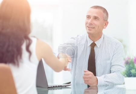 Image of business people interacting at meeting in office