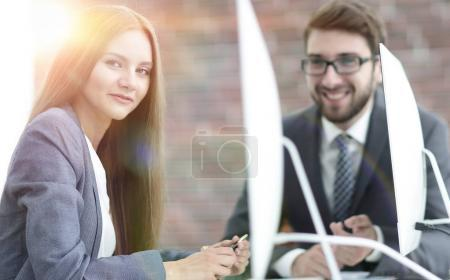 employees discuss work issues in the office