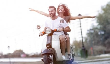 Photo for Happy cheerful couple riding vintage scooter. Travel concept. - Royalty Free Image