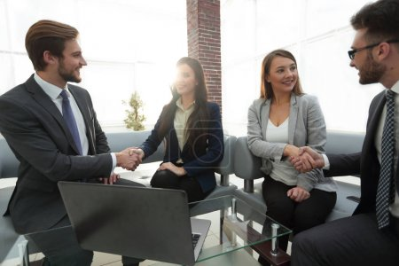 Photo for Business and office concept - businessmen and businesswomen shaking hands. - Royalty Free Image