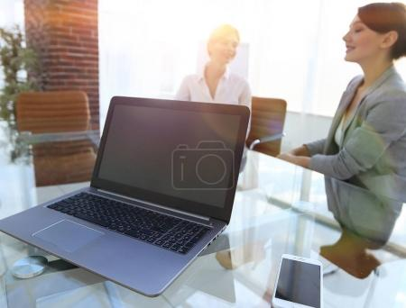 Photo for Laptop and a smartphone on the desktop of a businessman. workplace. - Royalty Free Image