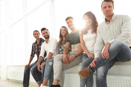 Photo for Group of young creative people sitting on chairs in waiting room - Royalty Free Image