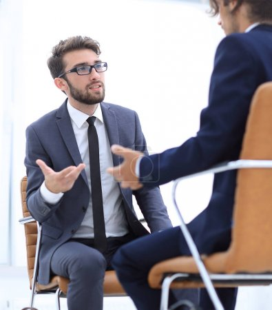 Two businessmen holding briefcases near themselves
