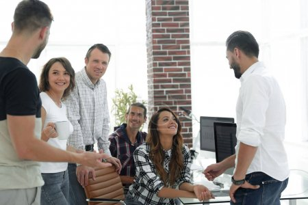 team of young employees discussing