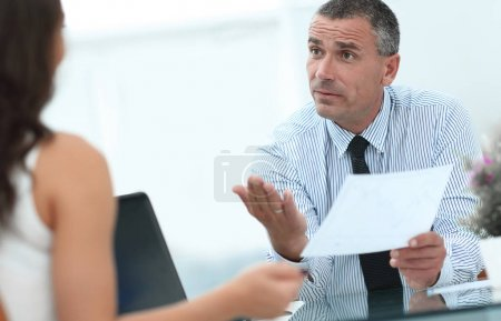 closeup. Manager discusses with the client the terms of the contract