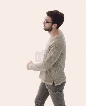 side view. modern young man confidently goes forward.