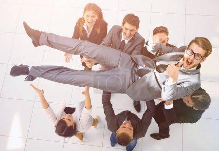triumphant business team shakes their leader