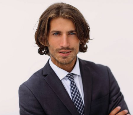 Photo for Portrait of a young handsome fashionable man against a white wall in a suit and tie - Royalty Free Image