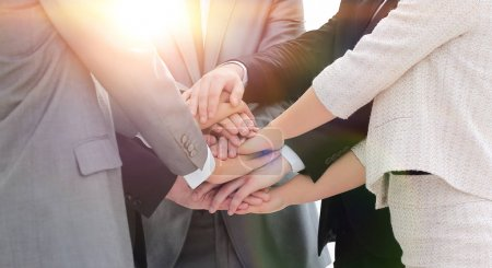 Photo for Concept of a reliable partnership. business team with folded hands together - Royalty Free Image