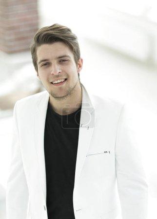handsome man in white jacket.