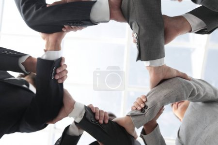 business team are taking each others hands