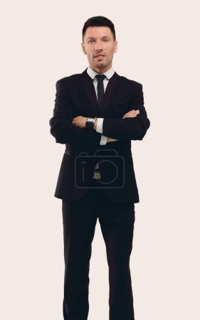 Full-length portrait of business man with hands crossed, isolate