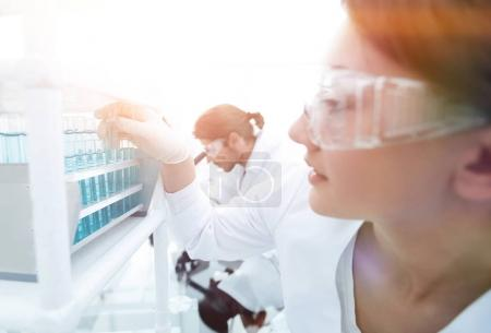 Young woman with test tubes in the laboratory