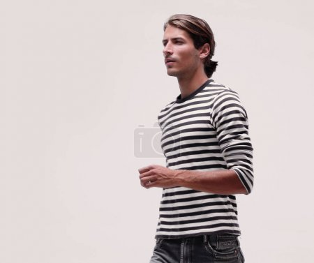 Side view.modern young man runs to his purpose