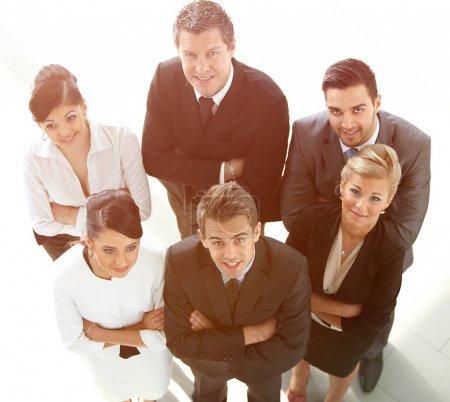 Photo pour Vue du haut. équipe d'affaires réussie à la recherche de camera.business concept - image libre de droit