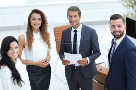 Photo for Successful employees standing in a modern office - Royalty Free Image